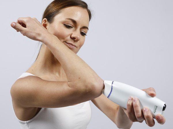 Laser behandling hemma armbåge